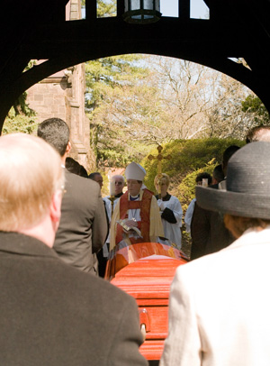 The burial service of Frederic W McFarland, at the lychgate of St Mary's